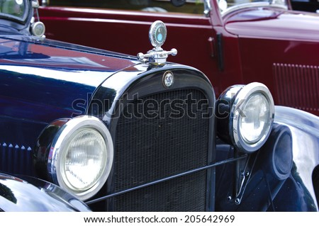 LANDSBERG, GERMANY - JULY 12, 2014: Public oldtimer rally in Bavarian city Landsberg for at least 80 years old veteran cars with a front view of Dodge Tourer, built at year 1924 - stock photo