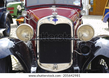 LANDSBERG, GERMANY - JULY 12, 2014: Public oldtimer rally in Bavarian city Landsberg for at least 80 years old veteran cars with a front view of Ford A, built at year 1930 - stock photo