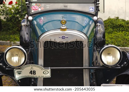 LANDSBERG, GERMANY - JULY 12, 2014: Public oldtimer rally in Bavarian city Landsberg for at least 80 years old veteran cars with a front view of Chevrolet K, built at year 1925 - stock photo