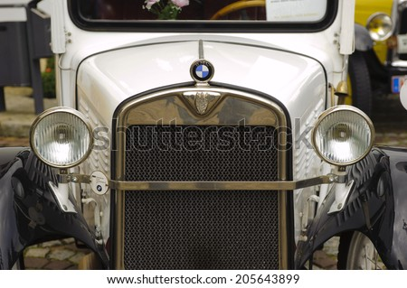LANDSBERG, GERMANY - JULY 12, 2014: Public oldtimer rally in Bavarian city Landsberg for at least 80 years old veteran cars with a front view of BMW Dixi, built at year 1929 - stock photo