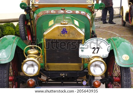 LANDSBERG, GERMANY - JULY 12, 2014: Public oldtimer rally in Bavarian city Landsberg for at least 80 years old veteran cars with a front view of Swift 7HP Phaeton, built at year 1914 - stock photo