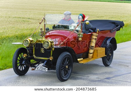 LANDSBERG, GERMANY - JULY 12, 2014: Public oldtimer rally organized by Bavarian city Landsberg for at least 80 years old veteran cars with unknown drivers in Rochet-Schneider 11000, built at year 1912