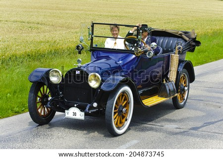 LANDSBERG, GERMANY - JULY 12, 2014: Public oldtimer rally organized by Bavarian city Landsberg for at least 80 years old veteran cars with unknown drivers in Buick 45 D, built at year 1915