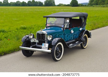 LANDSBERG, GERMANY - JULY 12, 2014: Public oldtimer rally organized by Bavarian city Landsberg for at least 80 years old veteran cars with unknown drivers in Chevrolet Cabrio K, built at year 1925