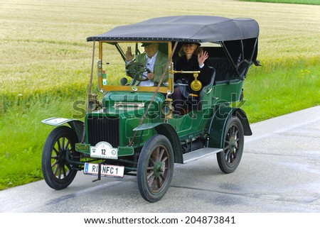 LANDSBERG, GERMANY - JULY 12, 2014: Public oldtimer rally organized by Bavarian city Landsberg for at least 80 years old veteran cars with unknown drivers in Rover 8 HP, built at year 1906