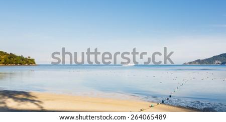 Landscape a sandy beach in tropics, the boat - stock photo