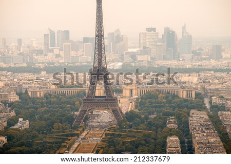 Landscape aerial view of Tour Eiffel on a cloudy day.