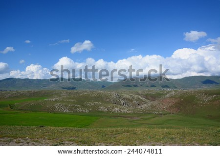 Landscape along roadside with dramatic clouds - stock photo
