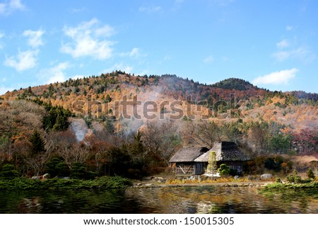 Landscape and Japanese house made of straw. - stock photo