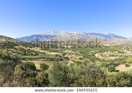 Landscape and Olive Groves in south Crete. Agriculture and Olive Groves determine the picture on the Island. In the background the Ida mountains with the Psiloritis as highest mountain on Crete. - stock photo