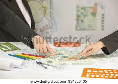 Landscape architect  meeting with client - stock photo