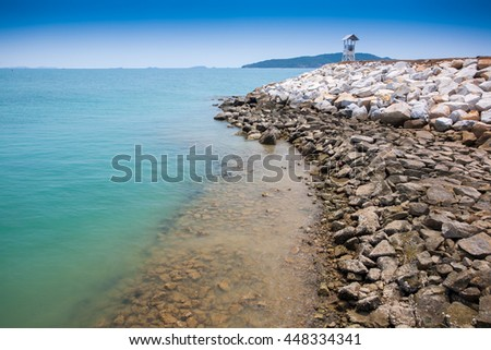Landscape beach and rock and blue sky with mountain background  - stock photo