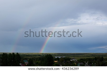 Landscape, bright rainbow after the rain.