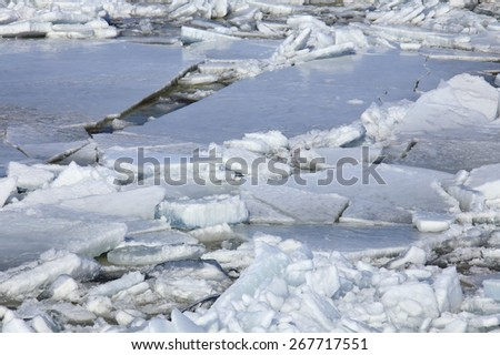 landscape close-up ice drift on the river in the spring on a sunny day  - stock photo