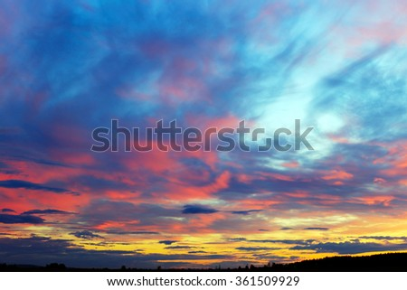 landscape colorful cirrus clouds against a blue sky at sunset