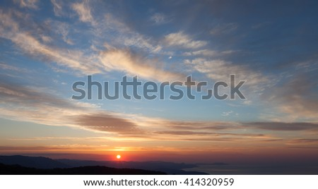 Landscape. Colorful sunset over the mountain and sea