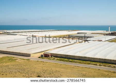 Landscape completely covered by the plastic of agricultural greenhouses - stock photo