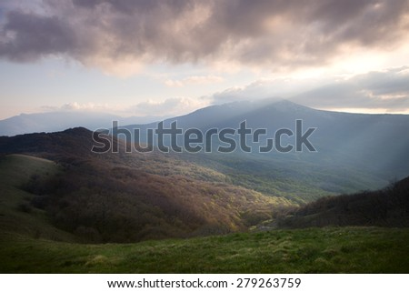 Landscape. Dawn over the mountains with clouds - stock photo
