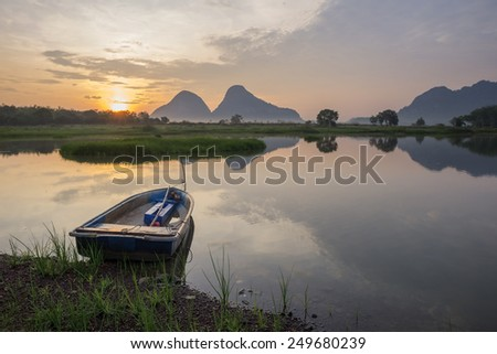 Landscape Early Morning with Boat in the Lake