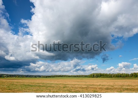 Landscape field and clouds summer, after the harvest - stock photo