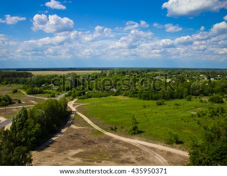 Landscape, field and forest with a height. - stock photo