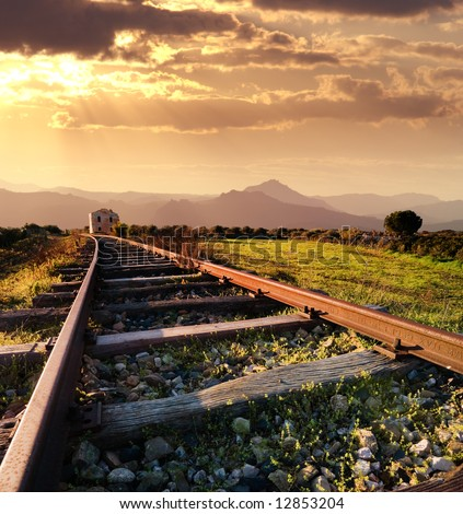 landscape for a old railway abandoned at the sunset - stock photo