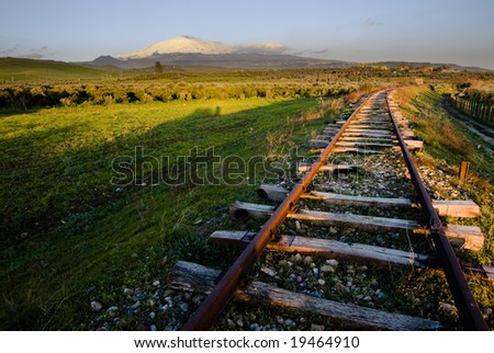 landscape for old railway abandoned and volcano Etna - stock photo