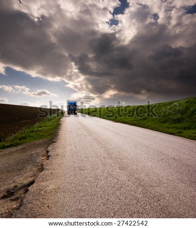 landscape for truck on road and stormy sky - stock photo