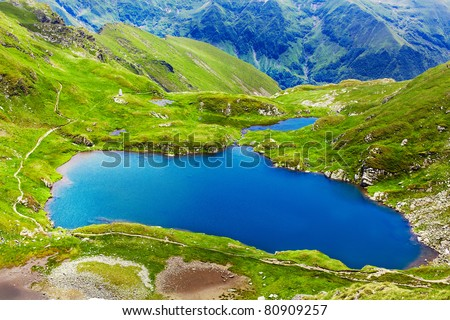 Landscape from Capra Lake in Romania and Fagaras mountains in the summer - stock photo