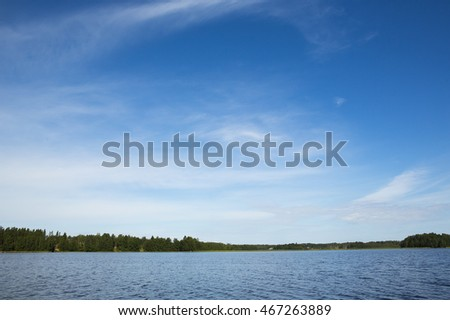 Landscape from Finland. An image of a scenery by the lake on a sunny summer day.