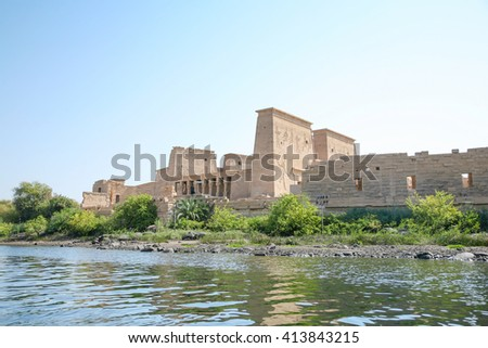landscape from water Nile River of landmark Philae Temple, ancient Egyptian public monument for the goddess Isis, declared a World Heritage by Unesco, in Agilkia island, Egypt, Africa - stock photo