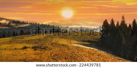 Landscape high mountains withconiferous forest and meadow at sunset in autumn - stock photo
