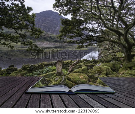 Landscape image of mountain reflected in calm lake on Summer morning conceptual book image - stock photo