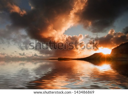 Landscape image of rocky beach at sunset with long exposure motion blur sea - stock photo