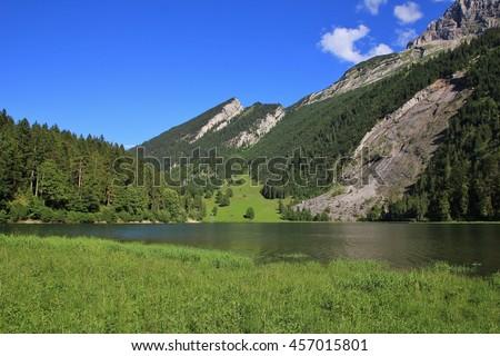 Landscape in Glarus Canton, Swiss Alps. Lake Obersee. - stock photo