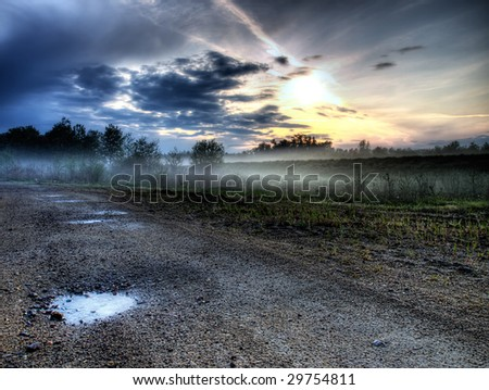 Landscape in HDR technique, sunset somewhere on the  continent. - stock photo