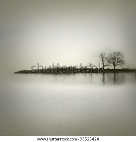 Landscape in sepia tones with isolated trees - stock photo