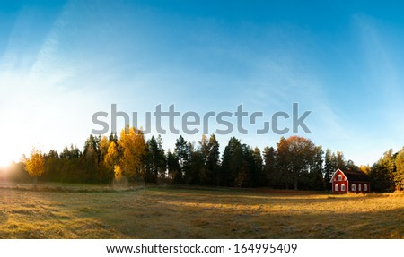 Landscape in Sweden with red wooden cottage in the swedish countryside in the Province of Smaland. 180 degrees panorama. - stock photo