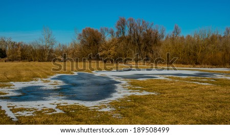 landscape in the countryside on a sunny day field - stock photo