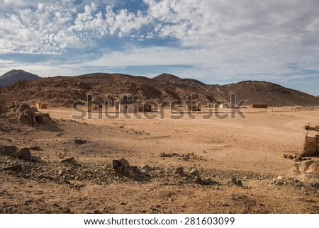 Landscape in the desert in Egypt. Rocky hills. Blue sky with many white clouds.