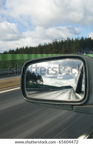 Landscape in the mirror of a car