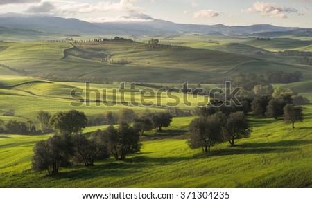 landscape in tuscany,Rolling hills, countryside farm,rural landscape in Italy - stock photo