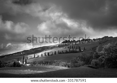 Landscape in Val d'Orcia. Tuscany, Italy. Black and white image. - stock photo