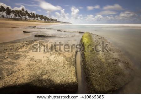 landscape long exposure of Costa do Sauipe in Bahia coast of Brazil - stock photo