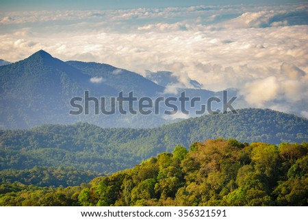 Landscape many mountain forest with sea mist behind winter of  Thailand at Chiang Mai  - stock photo