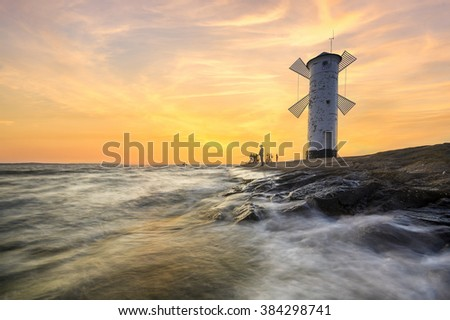landscape marine lighthouse in the shape of a windmill