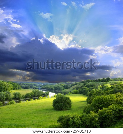 Landscape - meadow, the blue sky and river - stock photo
