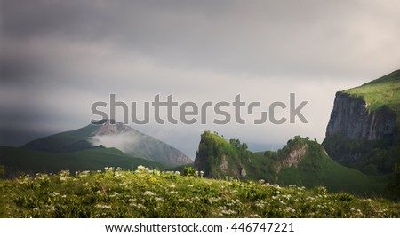 Landscape. Mountain ridges at against the sky with clouds. Caucasus, Russia  - stock photo