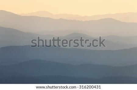 Landscape. Mountain ridges at sunrise - stock photo