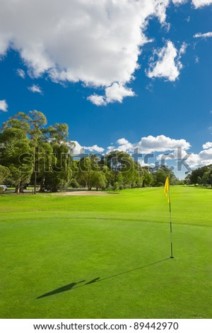 Landscape of a beautiful green golf course with sky - stock photo